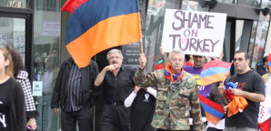 NEVER FORGET: Garo Armoudikian waves an Armenian flag and leads protesters to the Turkish consulate on April 24.