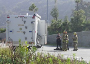 GCC Police and Glendale Fire wait by the LA Sheriff Bomb Squad vehicle Monday, while the bomb squad checked out the package in the parking structure.